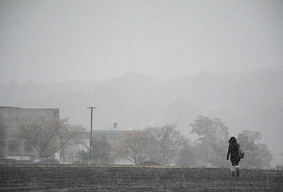 10/27/2016 Mike Orazzi | Staff The first snowfall of the season coast Centre Square in downtown Bristol Thursday morning.