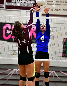 10/26/2016 Mike Orazzi | Staff Bristol Central's Kathryn Ross (14) and Bristol Eastern's Olivia Beaudoin (4)  during Wednesday night's match at Central.