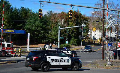 10/28/2016 Mike Orazzi | Staff A low hanging traffic light at the intersection of Route 6 and Burlington Avenue a windy Friday afternoon in Bristol.
