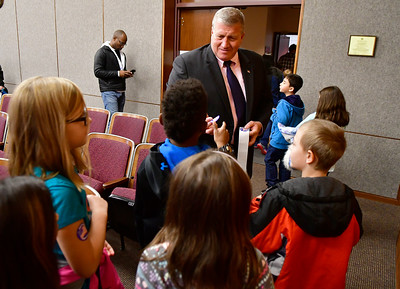 10/28/2016 Mike Orazzi | Staff Bristol Mayor Ken Cockayne passes out future voter stickers to third grade students during a class trip Bristol City Hall Friday afternoon.