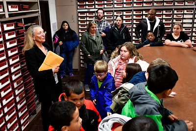 10/28/2016 Mike Orazzi | Staff Bristol Town Clerk Therese Pac talks with 3rd grade students during a tour of the records room in city hall Friday.