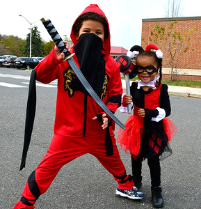 10/29/2016 Mike Orazzi | Staff Sebastian,5, and Julisa Martinez,3, during the New Britain Parks, Recreation and Community Services Department's Halloween Spooktacular at the Slade Middle School Saturday in New Britain.