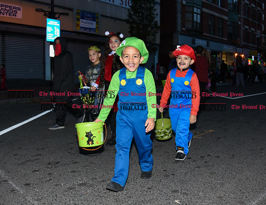 103116  Wesley Bunnell | Staff  The New Britain Safe Zone 2016 was held around Central Park Monday evening. Local businesses and city departments passed out candy to thousands of trick or treaters. Edwin Rodriguez, left, as Mario with Abraham Mendoza, age 6, as Luigi.