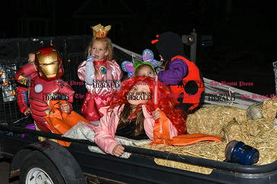 103116  Wesley Bunnell | Staff  Riding around the neighborhood trick or treating are, from left, Jameson Whipple as Iron Man, Leah Wethered as Princess Peach and Jaylynn Whipple