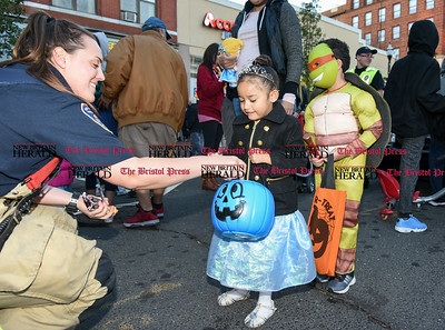 103116  Wesley Bunnell | Staff  The New Britain Safe Zone 2016 was held around Central Park Monday evening. Local businesses and city departments passed out candy to thousands of trick or treaters. Keisha Rodriguez, age 3, trick or treats with New Britain's firefighters.