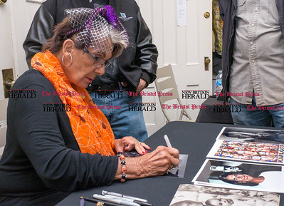 103116  Wesley Bunnell | Staff  Daughter of acting legend Boris Karloff, Sara Karloff, signed copies of photos for a crowd at the Witches Dungeon on Halloween night.