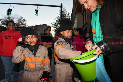 103116  Wesley Bunnell | Staff  The New Britain Safe Zone 2016 was held around Central Park Monday evening. Local businesses and city departments passed out candy to thousands of trick or treaters.  Congresswoman Elizabeth Esty passes out candy in front of city hall.