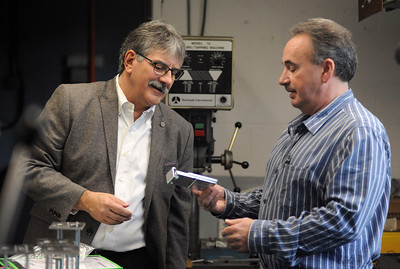 10/4/2016 Mike Orazzi | Staff Mike Nicastro talks with Modelcraft's Al Gravel during a tour of the Plymouth manufacturer Tuesday morning.