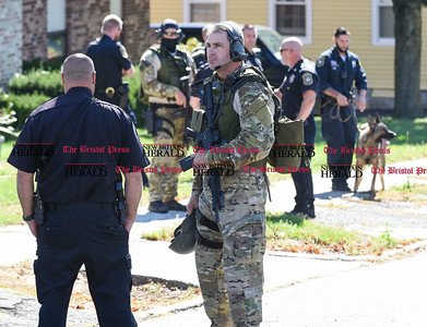 100516  Wesley Bunnell | Staff  New Britain Police officers begin to leave the scene of an hours long standoff at 265 Burritt St on Wednesday afternoon.