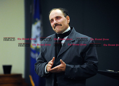 10/5/2016 Mike Orazzi | Staff  Props on had for actor and researcher Campbell Harmon as he portrays Edgar Allen Poe at Bristol Public Library Wednesday afternoon.