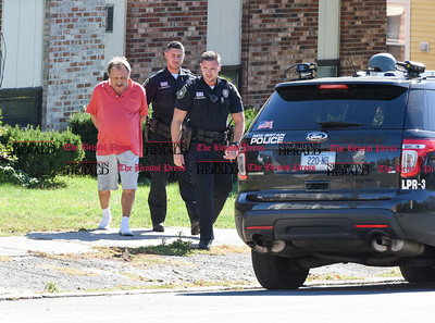 100516  Wesley Bunnell | Staff  New Britain Police officers lead the suspect after an hours long standoff on Wednesday afternoon from 265 Burritt St.