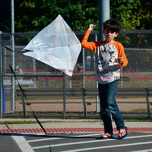 10/5/2016 Mike Orazzi | Staff  Leonardo Soethe,8, while flying a kite off Lake Avenue in Bristol Wednesday.