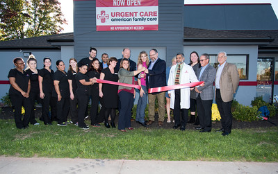 100616  Wesley Bunnell | Staff  AFC Urgent Care held an official ribbon cutting and opening ceremony on Thursday afternoon at their newest location on East Main St. Mayor Erin Stewart is shown cutting the ribbon with owner Tom Kelly as staff and local political figures look on.