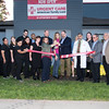100616  Wesley Bunnell | Staff<br /> <br /> AFC Urgent Care held an official ribbon cutting and opening ceremony on Thursday afternoon at their newest location on East Main St. Mayor Erin Stewart is shown cutting the ribbon with owner Tom Kelly as staff and local political figures look on.