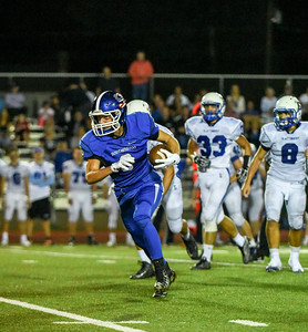 092316  Wesley Bunnell | Staff  Southington Football vs. Glastonbury at Southington High School on Friday September 23rd. Junior Wide Receiver Jack Herms #8 runs for yards after the catch.