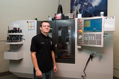 100716  Wesley Bunnell   Staff  Senior Bartosz Gorecki of E.C. Goodwin Technical High School in New Britain works with a computer programed CNC Mill as part of the Precision Machining Technology program.