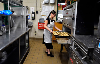 10/7/2016 Mike Orazzi | Staff Bristol Tech Culinary Arts' Debrah Gerena while baking chocolate chip cookies Friday morning.