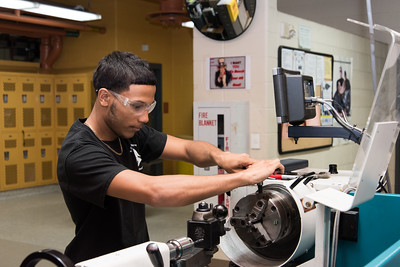 100716  Wesley Bunnell | Staff  Senior Nathan Martinez of E.C. Goodwin Technical High School in New Britain works with a lathe as part of the Precision Machining Technology program.