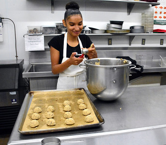 10/7/2016 Mike Orazzi | Staff Bristol Tech Culinary Arts' Alize Marrero while baking chocolate chip cookies Friday morning.