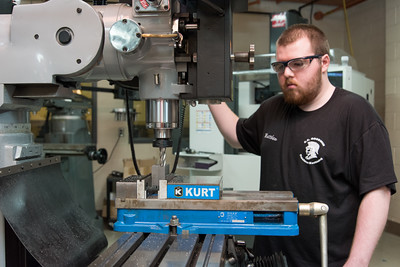 100716  Wesley Bunnell | Staff  Senior Matthew Saccente of E.C. Goodwin Technical High School in New Britain shown working with a milling machine as part of the Precision Machining Technology program.