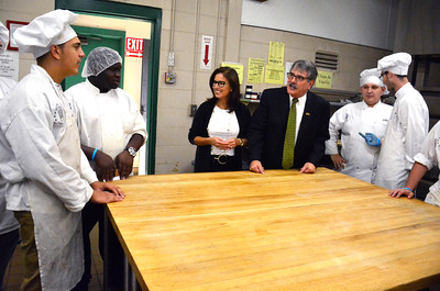 10/7/2016 Mike Orazzi | Staff State senate candidate Mike Nicastro and state senator Gayle Slossberg talk with Bristol Tech Culinary Arts students during a tour Friday morning.