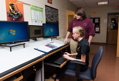 100716  Wesley Bunnell   Staff  Freshman Chloe Layfulde , seated, receives help from Senior Chris Gadomski at E.C. Goodwin Technical High School in New Britain. Freshman are in the expiatory first phase of the CADD program currently designing keychains.