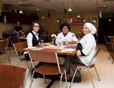 100716  Wesley Bunnell | Staff  Culinary Arts Students , from left, Isabella Lopez, Crispin Lopez and Kearria Diaz of E.C. Goodwin Technical High School sit inside Cafe Chives which is a student run full service restaurant on the campus.