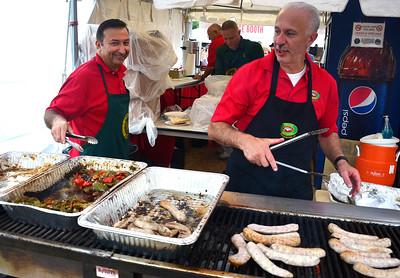 10/8/2016 Mike Orazzi | Staff UNICO's Pat Brino and Nick Veltri cook sausage and peppers during the Southington Apple Harvest Festival on Saturday.