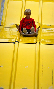 10/8/2016 Mike Orazzi | Staff Seany Jameson on the slide during the Southington Apple Harvest Festival on Saturday.