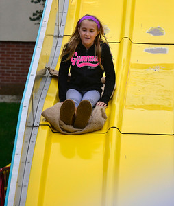 10/8/2016 Mike Orazzi | Staff Kelly Jameson on the slide during the Southington Apple Harvest Festival on Saturday.