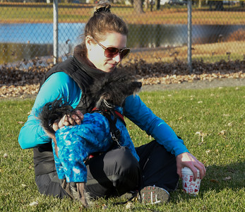 111416  Wesley Bunnell | Staff  Meghan Knight of New Britain plays with her dog in pajamas. Mooshu is a one year old Hairless Chinese Crested.