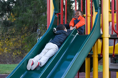 111416  Wesley Bunnell | Staff  Amgen Miller, age 4, of Bristol comes to the pretend rescue of friend Demetrius , age 6, while playing at the Page Park All Childrens Playground on Monday afternoon.