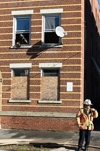 111416  Wesley Bunnell | Staff  A fire in a boarding up building broke out around noon on Monday at 189 Oak St in New Britain.