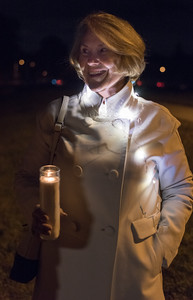 111416  Wesley Bunnell | Staff  Bristol residents came together at Memorial Boulevard School on Monday evening for  'An Evening Of Unity & Solidarity' after Trump's  win.  Carol Denehy of Bristol stands with a candle during the presentation.