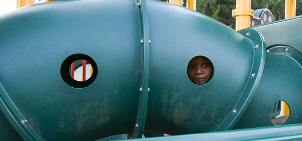 111416  Wesley Bunnell | Staff  Ayden Miller, age 4 of Bristol peaks through on a playscape at the Page Park All Childrens Playground on Monday afternoon.