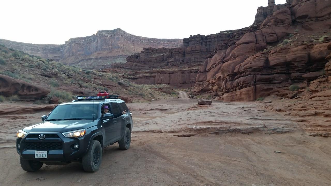 Meredith navigates some rock shelves on Potash Road near Moab, Utah.