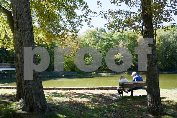 10/02/17 Wesley Bunnell | Staff Hilda Garcia and Yan Stachelek both of Bristol sit by the side of Page Park Lagoon on Monday afternoon.