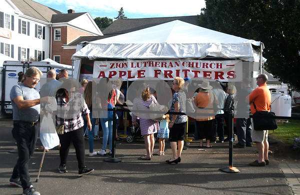 10/6/2017 Mike Orazzi | Staff The line for Zion Lutheran Church apple fritters during the 49th Apple Harvest Festival in Southington Friday evening.