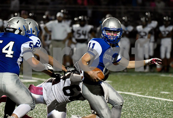 10/6/2017 Mike Orazzi | Staff Bristol Eastern's Justin Marshall (11) tackled by Farmington's Jermaine Carter (66) Friday night in Bristol.
