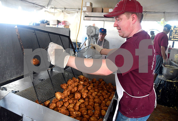 10/6/2017 Mike Orazzi | Staff Peter Redline while working making Zion Lutheran Church apple fritters during the 49th Apple Harvest Festival in Southington Friday evening.