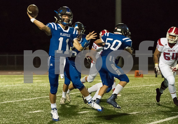 10/06/17 Wesley Bunnell | Staff Berlin football vs Plainville at Plainville High School on Friday night. Plainville quarterback Frank Griffin (11) passes while being protected by offensive lineman Nicholas Cianchetti (50).
