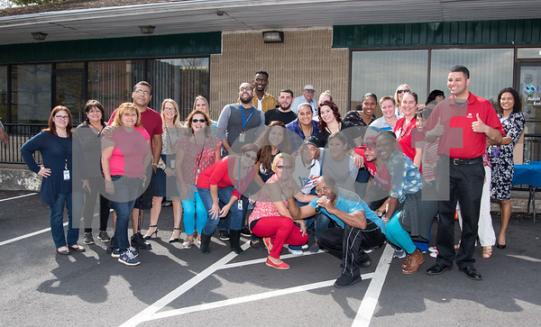 10/06/17 Wesley Bunnell | Staff CMHA and Puerto Rican Society of New Britain held a relief drive at CMHA on Whiting St on noon on Friday. Volunteers including many from CMHA pose for a group photo.