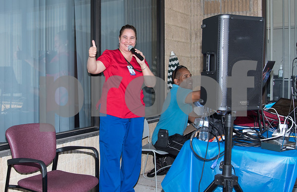 10/06/17 Wesley Bunnell | Staff CMHA and Puerto Rican Society of New Britain held a relief drive at CMHA on Whiting St on noon on Friday. Medical Assistant Carmen Vivas gives the thumbs up after speaking to both helpers and people donating items. DJ Willis donated his services.