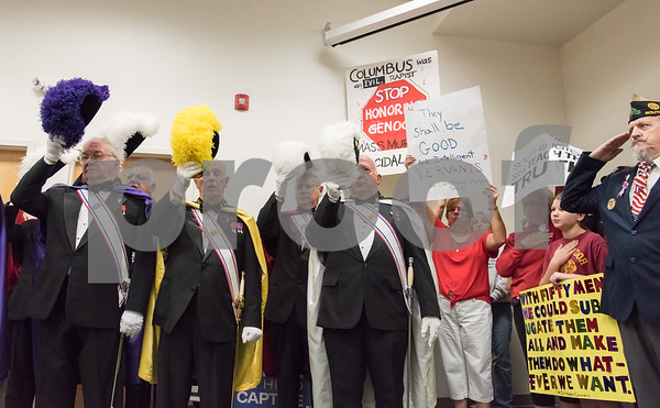 A ceremony was held on Monday morning at the Southington Municipal Center for the dedication and unveiling of the Christopher Columbus Monument honoring the 525th anniversary of the discovery of America. The Knights of Columbus Color Guard salute during the National Anthem as protestors against Christopher Columbus stand next to them.