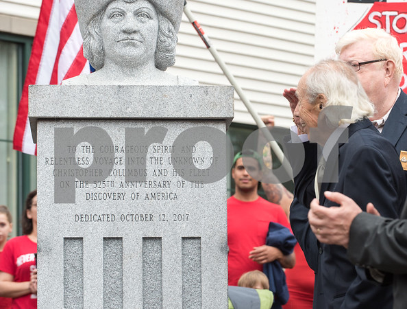 A ceremony was held on Monday morning at the Southington Municipal Center for the dedication and unveiling of the Christopher Columbus Monument honoring the 525th anniversary of the discovery of America. Dick Fortunato salutes the statue of Columbus after the unveiling.