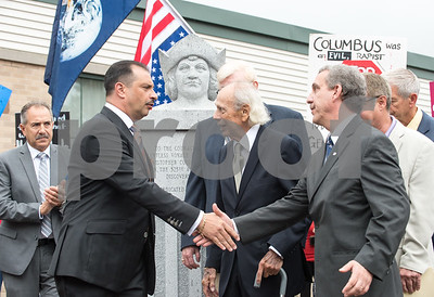 A ceremony was held on Monday morning at the Southington Municipal Center for the dedication and unveiling of the Christopher Columbus Monument honoring the 525th anniversary of the discovery of America. President of UNICO and Sons of Italy President Antonio Cusano, second from L, and Dick Fortunato.