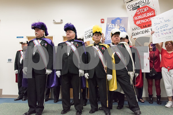 A ceremony was held on Monday morning at the Southington Municipal Center for the dedication and unveiling of the Christopher Columbus Monument honoring the 525th anniversary of the discovery of America. The Knights of Columbus Color Guard stand next to protestors against Christopher Columbus.
