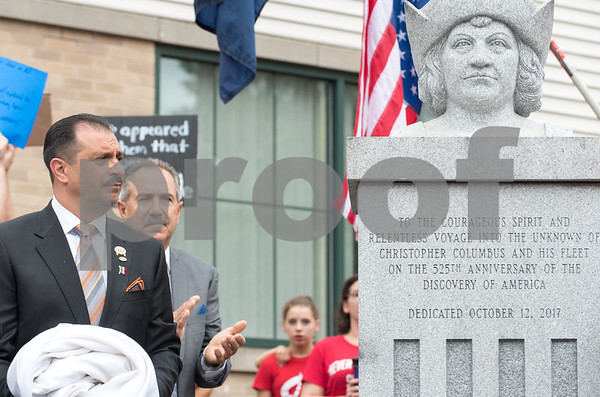 A ceremony was held on Monday morning at the Southington Municipal Center for the dedication and unveiling of the Christopher Columbus Monument honoring the 525th anniversary of the discovery of America. President of UNICO and Sons of Italy President Antonio Cusano after helping to unveil the statue.