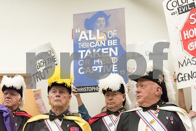 A ceremony was held on Monday morning at the Southington Municipal Center for the dedication and unveiling of the Christopher Columbus Monument honoring the 525th anniversary of the discovery of America.  Protestors against Christopher Columbus stand behind the Knights of Columbus Color Guard.