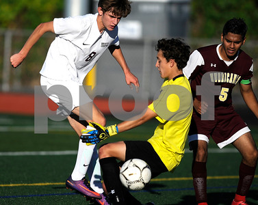 10/10/2017 Mike Orazzi | Staff Bristol Central's David Bowes (8) and New Britain's Adam Gottner (GK) during Tuesday's soccer at Bristol Central.